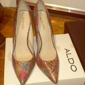 Multi colored snake skin shoes.